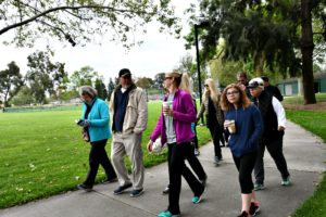 Walk'n' Talk group walking in a park -build healthy communities where we live