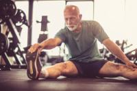 Elderly man stretching and exercising